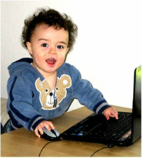 toddler on the computer